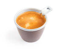 Espresso coffee in a disposable cup on white. Background Royalty Free Stock Photography