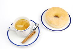 Espresso coffee and donut Stock Photos