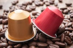 Espresso coffee doses with coffee beans. Closeup of colorful espresso coffee doses with coffee beans on wooden table background stock photos