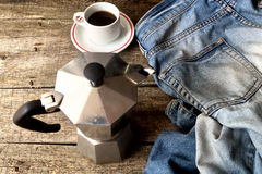 Espresso coffee, espresso maker and dirty jeans Royalty Free Stock Image