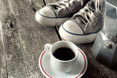 Espresso coffee, espresso maker and dirty sneakers Stock Image