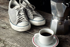 Espresso coffee, espresso maker and dirty sneakers Royalty Free Stock Images