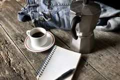 Espresso coffee, espresso maker, notepad and dirty jeans Stock Photo