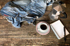 Espresso coffee, espresso maker, notepad and dirty jeans Stock Image
