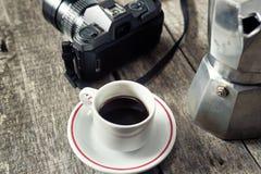 Espresso coffee, espresso maker and vintage camera Royalty Free Stock Photo
