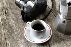 Espresso coffee, espresso maker and vintage camera Royalty Free Stock Images