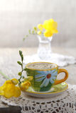 Espresso coffee with flowers and crochet place mat Stock Photography