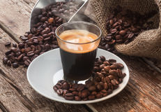 Espresso coffee in glass cup with coffee beans. Royalty Free Stock Photography