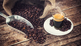 Espresso coffee in glass cup with coffee beans. Stock Image