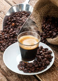 Espresso coffee in glass cup with coffee beans. Stock Photography