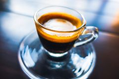 Espresso coffee in glass cup Stock Photos