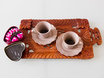 Espresso coffee with heart-shaped chocolates Royalty Free Stock Image