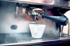 Espresso coffee machine brewing fresh, bio coffee Royalty Free Stock Image