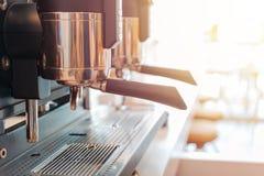 Espresso coffee machine in restaurant with warm sun glow. Close stock photography