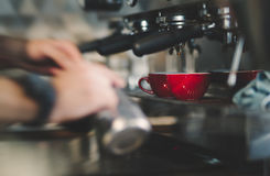 Espresso coffee made by machine Royalty Free Stock Image