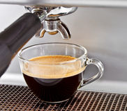 Espresso from coffee maker Stock Photography