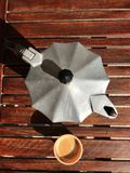 Espresso coffee maker. On wooden table Royalty Free Stock Photos