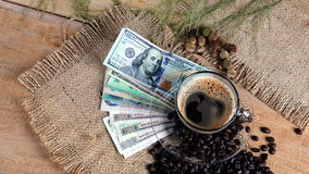 Espresso coffee and money bills, business. Royalty Free Stock Image