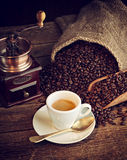 Espresso coffee with old coffee grinder Royalty Free Stock Photo
