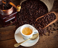 Espresso coffee with old coffee grinder Royalty Free Stock Image
