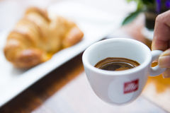 Espresso coffee in small mug with croissant Stock Photos
