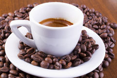 Espresso coffee surrounded with coffee beans Stock Image