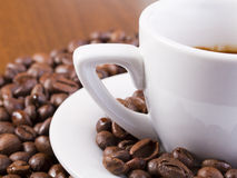 Espresso Coffee Surrounded With Coffee Beans Royalty Free Stock Image