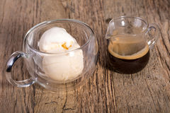 Espresso coffee and Vanilla ice cream in double walled glass italian dessert, on the rustic wooden table Royalty Free Stock Image