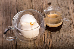 Espresso coffee and Vanilla ice cream in double walled glass italian dessert, on the rustic wooden table Royalty Free Stock Images