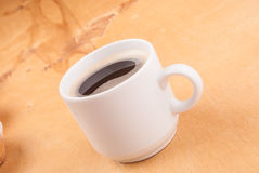 Espresso coffee in a white china cup over wood. Surface stock photo