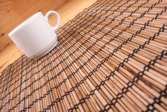 Espresso coffee in a white china cup over wood. En mat stock images