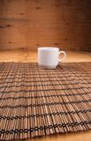 Espresso coffee in a white china cup over wood. En mat stock photography