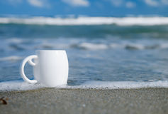 Espresso coffee in white cup with ocean waves Stock Photo