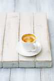 Espresso coffee in white cup on old rustic  style table Stock Images