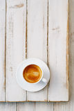 Espresso coffee in white cup on old rustic  style table Royalty Free Stock Images