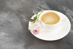 Espresso coffee in a white cup and a pink rose on a dark backgro. Und. Copy space. Food background. Toning Stock Photo