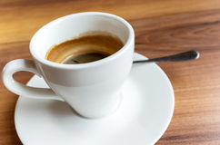 Espresso coffee in a white cup on saucer Stock Photo