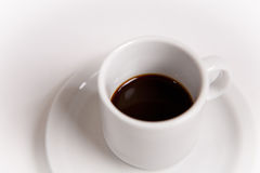 Espresso coffee in white cup on saucer Royalty Free Stock Image