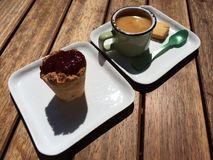 Espresso with cookie and raspberry. Delisious dessert after mediterranian Royalty Free Stock Photos
