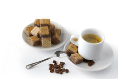 Espresso and cookies. Espresso coffee with cookies and roasted coffee beans over white background Royalty Free Stock Photos