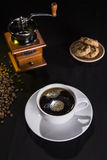Espresso and cookies. A cup of fresh espresos with cookies and coffe beans Stock Photography