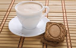 Espresso with cookies on mat Stock Image