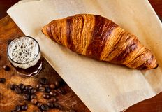 Espresso with croissant Stock Photos