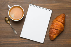 Espresso, croissant and notepads, photo concept, top view Stock Image