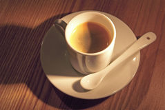 Espresso Cup (2). A cup of warm coffee on a warm wood background Stock Image