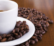 Espresso cup. Showing only half of espresso cup surrounded with coffee beans Stock Photo