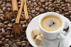 Espresso cup. Espresso with coffee beans, spoon and sugar royalty free stock photography