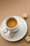 Espresso Cup. With sugar cubes over a light brown background royalty free stock image