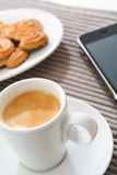 Espresso Cup. And modern mobile phone royalty free stock photo
