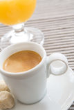 Espresso Cup. Expresso cup and glass of orange juice stock image